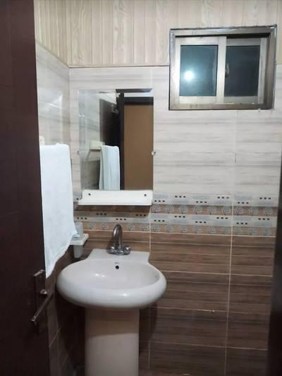 17 rooms attach bath kitchen  store security  cameras rent @400000 9